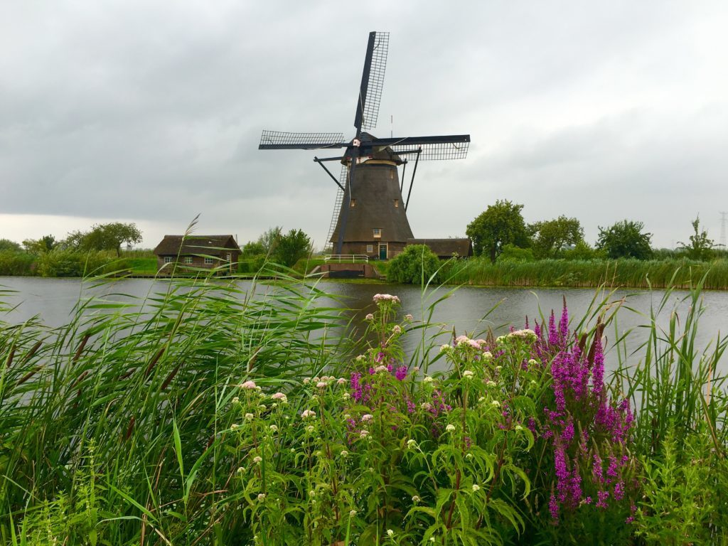 If you are looking for some Netherlands travel inspiration, check this out. Most visitors to the Netherlands don't even make it out of Amsterdam! So taking a day trip to Kinderdijk will be an opportunity to stray far from the beaten path, go on an adventure, and experience over 740 years of Dutch history. This post information on why Kinderdijk is so special and worth visiting, as well as what to do and see while you're there. When you travel to Amsterdam and other places in the Netherlands, make sure that you include Kinderdijk in your itinerary. This wanderlust-invoking destination is a must!