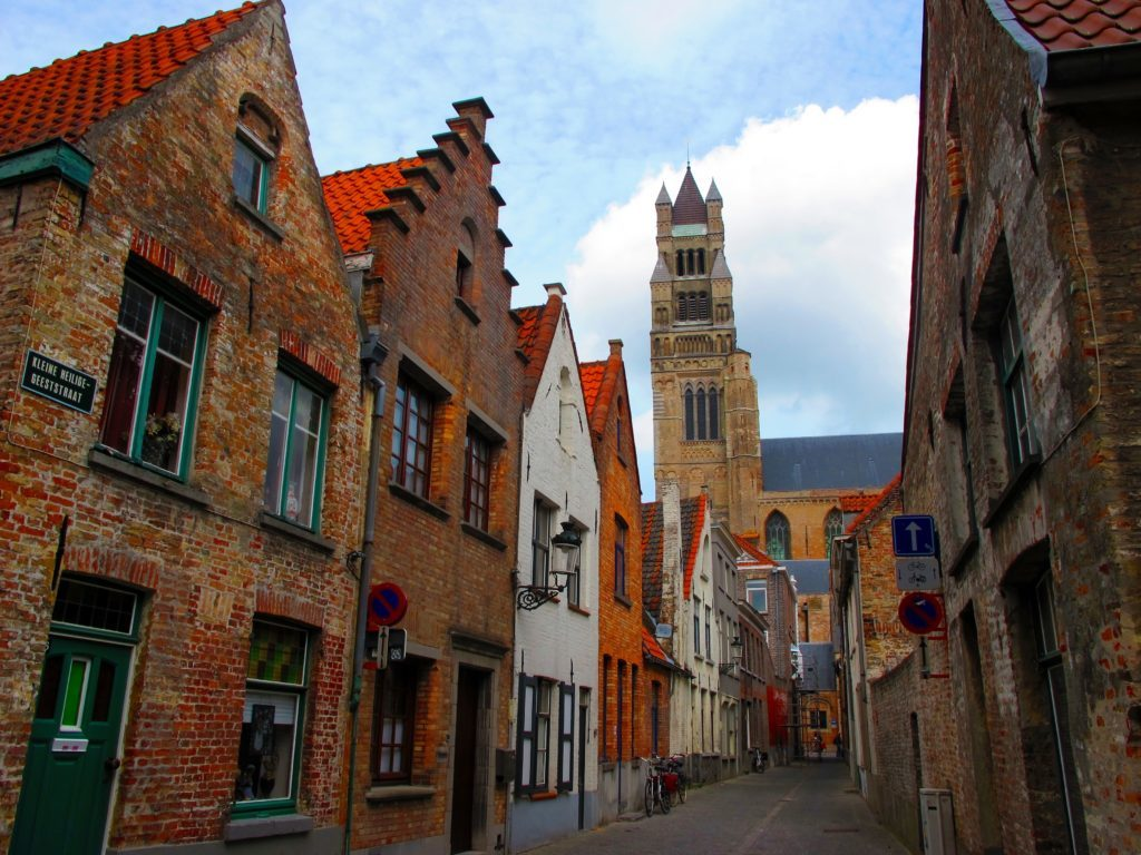 Looking for some Belgium travel inspiration to fuel your wanderlust? If you're visiting Belgium, make sure not to miss Bruges! While there, experience these 10 quintessential things to do in Bruges, and you will be in for an awesome two days. From the city's romantic canals, cobbled streets, and chocolate shops galore, to its bright-colored, centuries-old architecture and scrumptious food, Bruges is a city unlike any other. Here's is our guide to spending two days in Bruges, Belgium, including activities like wandering the city aimlessly, cruising the canals, eating, drinking, and exploring Bruges's highlights. After spending two days in Bruges, you'll have fallen head over heels in love with the city -- and that's pretty much a guarantee!