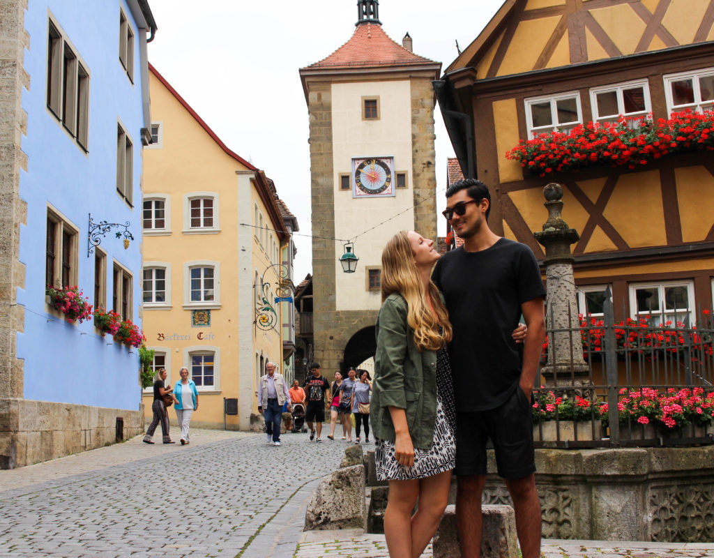 Is Rothenburg ob der Tauber the cutest medieval town in all of Europe? Between the quaint cobblestone streets of the perfectly preserved town, the surrounding fortress walls, the centuries-old colorful buildings, and all of the year-round Christmas shops, we sure think so! Here's what to do, where to eat, and where to stay in Rothenburg! Make sure to add this magical town to your Germany trip itinerary.