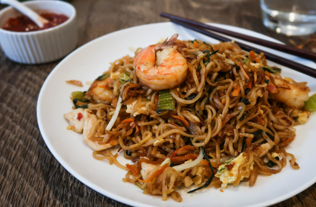 Mie goreng is a delicious and traditional dish of fried noodles found throughout Indonesia. A good mie goreng is equal parts sweet, salty, and umami, and packed with fresh vegetables and tender chicken and/or shrimp. And between the chewy noodles, fried shallots, crunchy bean sprouts, scrambled eggs, and succulent proteins, there are lots of interesting textures going on in each bite. There are very few (if any?) noodle dishes I love more than this one, and I know you're going to feel the same way. Next time you cook, try this mie goreng recipe!
