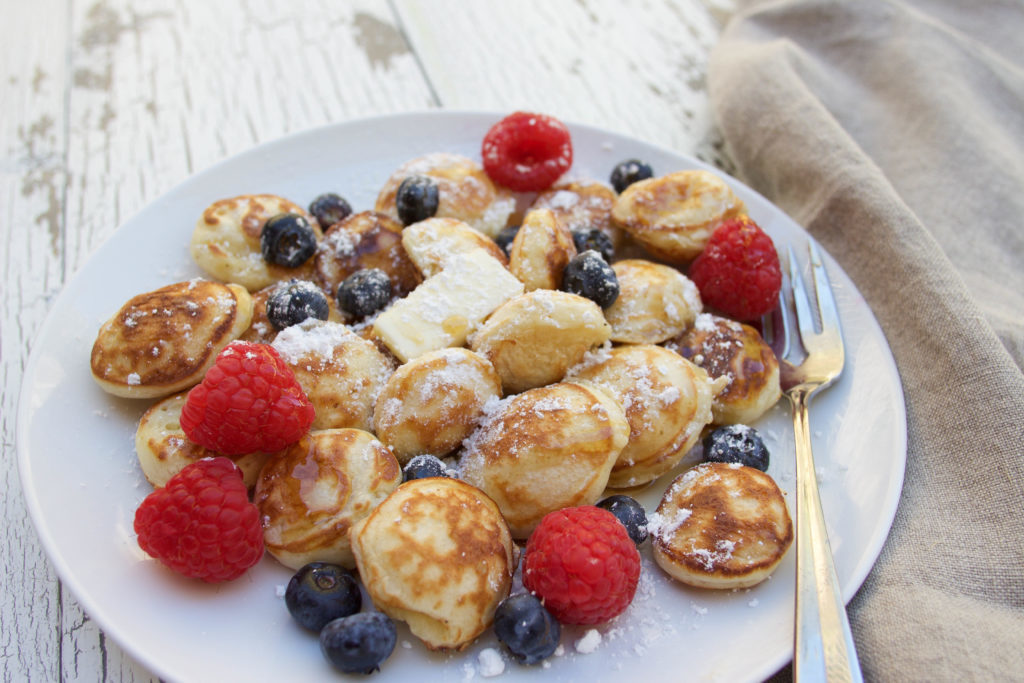 If you're looking for an authentic poffertjes recipe, then look no further! Poffertjes, also known as mini Dutch pancakes, are the perfect sweet treat, for breakfast or a late-night snack. This mini pancakes recipe yields the cutest, fluffiest little pancakes, and you are going to love them! Serve them the traditional way with some butter and powdered sugar, or add other toppings like syrup, berries, whipped cream, or even ice cream! Yummy!