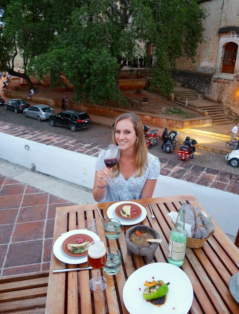 Maddy eating at Casa Oaxaca on the rooftop - one of the best places to eat in Oaxaca.