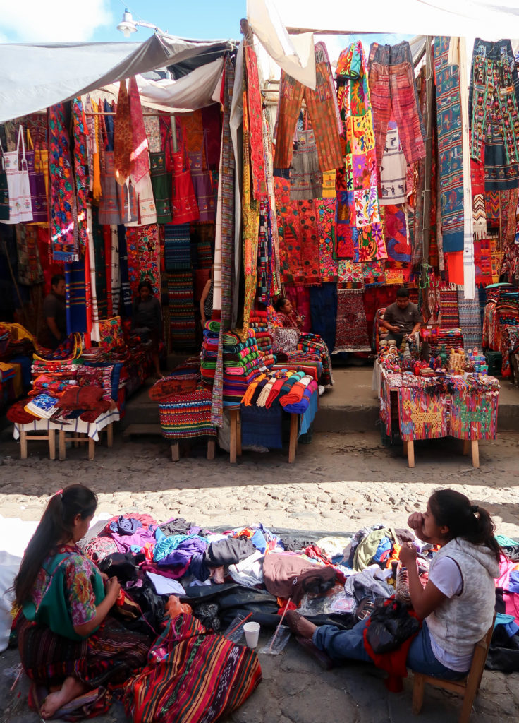 During your travels to Guatemala, you must go to the Chichicastenango Market! Every Thursday and Sunday, the tiny town of Chichicastenango, Guatemala turns into the world's largest handicrafts market, filled with thousands of local Mayan people purchasing and selling goods of all types. From colorful textiles and pottery, to traditional clothing and intricately carved masks, you will find a culmination of all of Guatemala's best goods and souvenirs at this market.