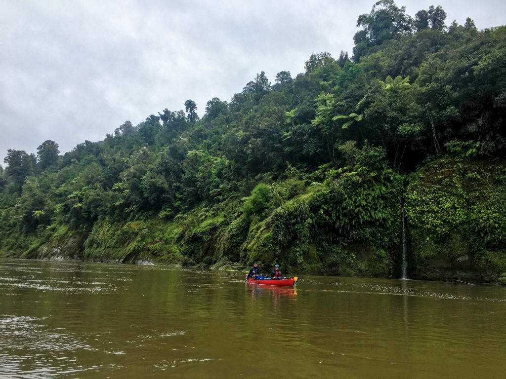 Visiting New Zealand and want to do something epic in the outdoors? Then consider the Whanganui River Journey! This three-day canoeing expedition is one of the most unique and adventurous things you might ever do. Here's what it's like to canoe down the Whanganui River. New Zealand Travel | North Island | Things to Do |
