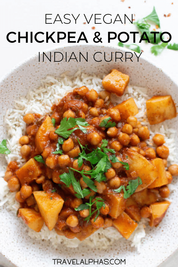 This vegan chana aloo masala, also known as Indian chickpea and potato curry, is delicious, easy to make, and very healthy. This authentic Indian curry recipe has a tomato base and incorporates lots of warming spices and bright herbs. Packed with flavor, it includes garam masala, clove, star anis, garlic, ginger, turmeric, cinnamon, bay leaves, cumin, jalapeño, and onion, among other ingredients. Ready in less than one hour, this vegan / vegetarian curry is so satisfying, perfect for a weeknight meal, meal prep, or a dinner party. Served, over basmati rice and topped with cilantro, you will love this traditional recipe for chana aloo masala curry.