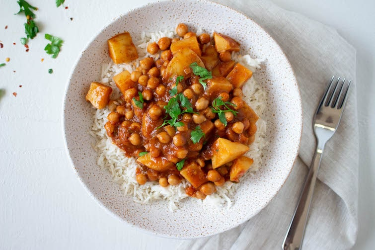 Vegan chana aloo masala, also known as Indian chickpea and potato curry, is delicious and nutritious. Packed with spices, herbs, and vegetables, and served over basmati rice, you will love this plant-based meal.