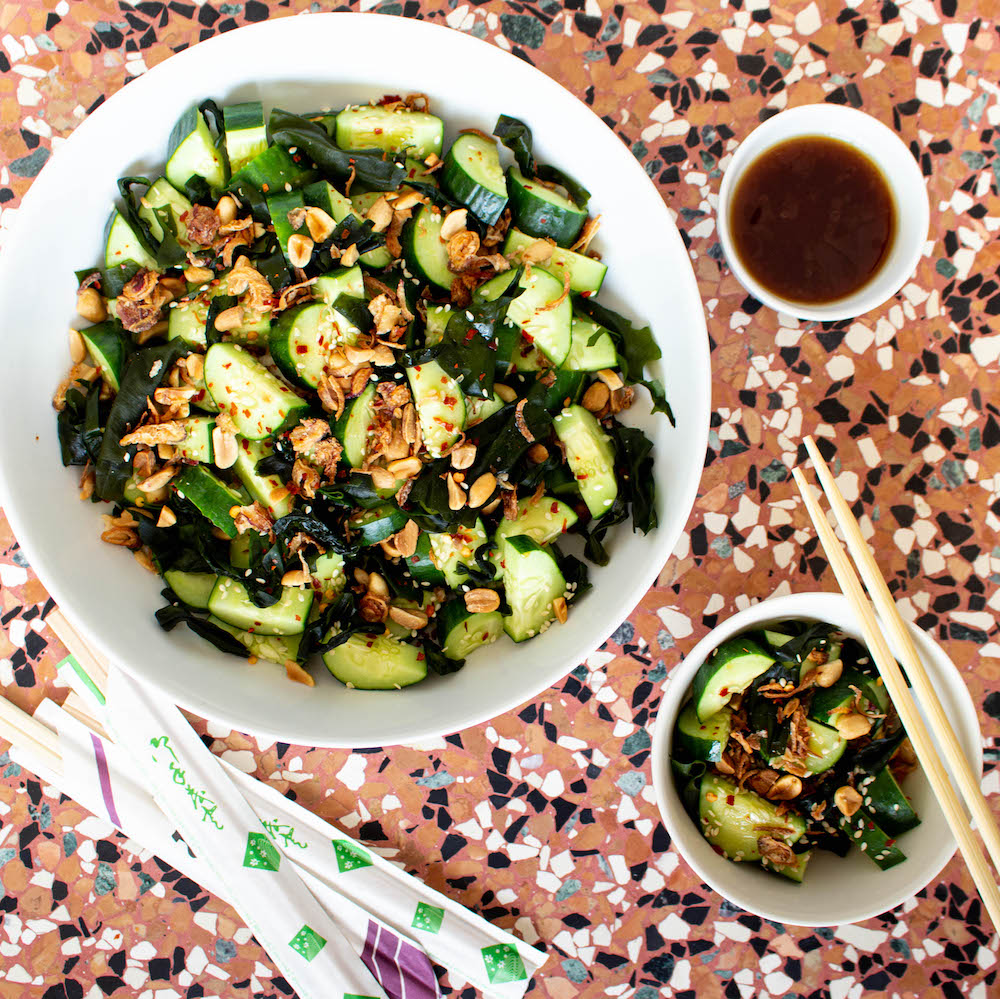 Asian cucumber salad with wakame seaweed, peanuts, sesame seeds, and chili. Ready in 10 minutes!