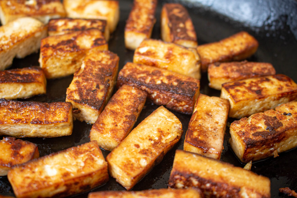 How to fry marinated tofu until crispy.
