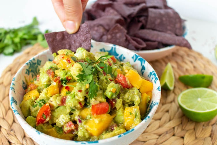 Mango Guacamole and Tortilla Chips. Want to know how to make the best mango guacamole? This mouthwatering recipe is very quick, easy, delicious, and authentic. It's the ultimate crowd-pleaser!