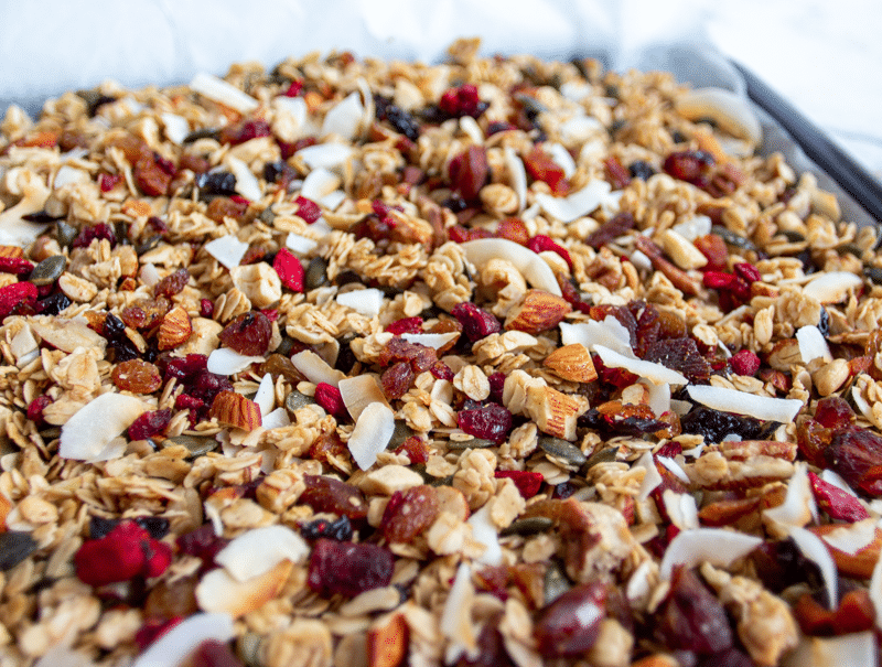 This is the best homemade granola recipe. It's healthy and easy, and loaded with oats, nuts, seeds, fruit, and coated in maple, vanilla, cinnamon, and coconut oil. Crunchy, chewy, sweet, salty, and so addictive, you're going to love this breakfast treat!