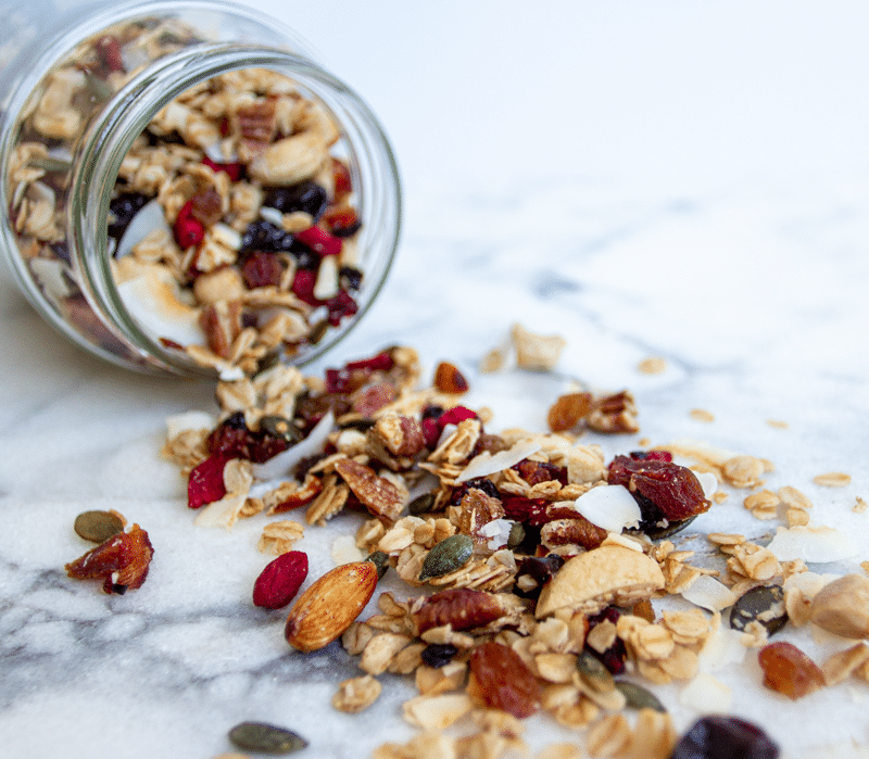 Granola stored in a jar. This is the best homemade granola recipe. It's healthy and easy, and loaded with oats, nuts, seeds, fruit, and coated in maple, vanilla, cinnamon, and coconut oil. Crunchy, chewy, sweet, salty, and so addictive, you're going to love this breakfast treat!