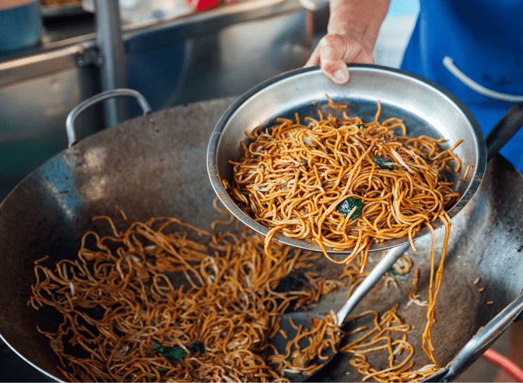 Eating street food and how not to get sick. These are the top ten tips on how to avoid traveler's diarrhea and food poisoning while traveling in developing countries like India, Mexico, and Thailand, and places like Bali, and regions like Southeast Asia, South America, and Central America. If you're embarking on a holiday to a faraway land, here are my top ten tips for steering clear of Montezuma's Revenge.