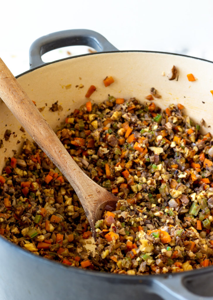The carrots, celery, onion, garlic mushrooms, and walnuts in a pot to make the perfect for making vegan bolognese sauce. This lentil bolognese with mushrooms and walnuts is the best!