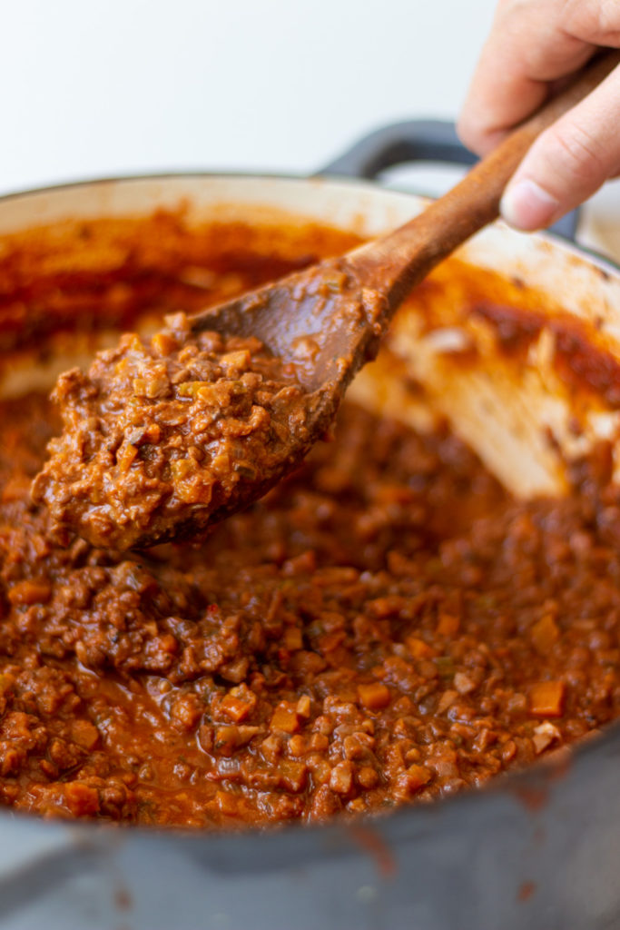 The best vegan bolognese sauce recipe with lentils, mushrooms, and walnuts. Perfect for making vegan pasta bolognese, vegan lasagna, and more!