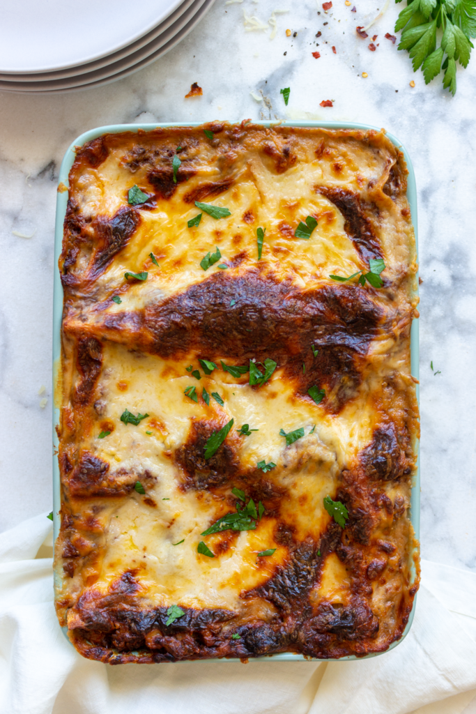 The best vegetarian lasagna recipe, layered with vegan bolognese sauce (with mushrooms, lentils & walnuts), a spinach-ricotta mixture, mozzarella cheese, and béchamel sauce!