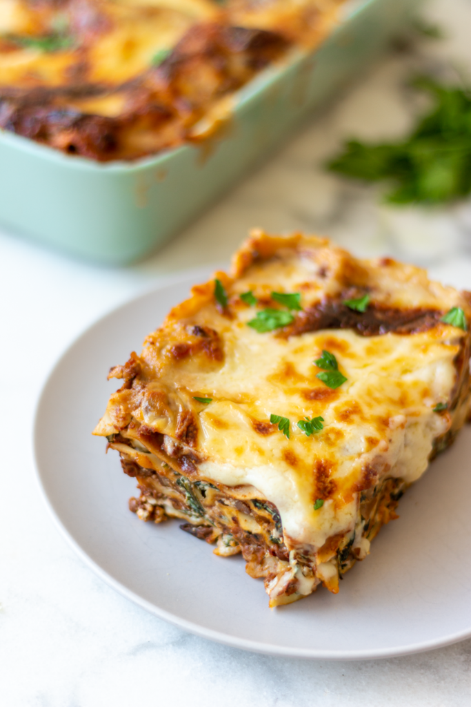 This is the world's best recipe for vegetable lasagne with bolognese sauce and béchamel, garnished with truffle oil and fresh parsley.
