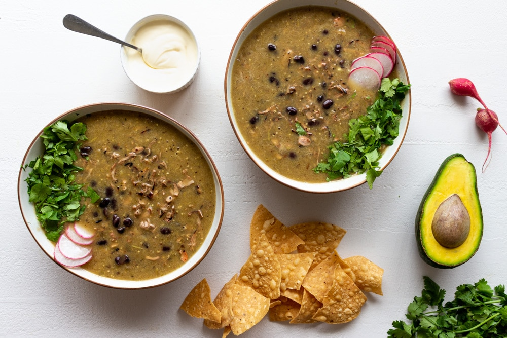 Inspired by the bold, bright flavors of México, this Roasted Tomatillo and Black Bean Soup with Pulled Jackfruit is what soup dreams are made of! In this recipe, roasted tomatillos, jalapeños, onions, garlic, and spices come together with black beans and spicy pulled jackfruit to create a soup that's tangy, spicy, earthy, and 100% delicious.
