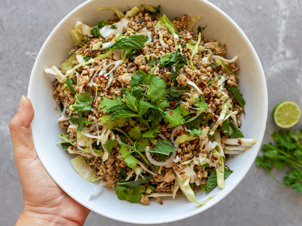 Authentic recipe for vegan larb, made with shiitake mushrooms and crumbled tofu.