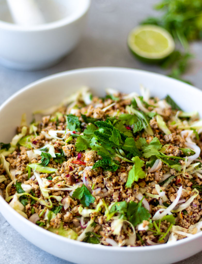 This larb is made with shiitake mushrooms and crumbled tofu. It's packed with texture and the flavors of lime, chili, toasted sticky rice, lemongrass, and fresh herbs. It's probably the greatest salad ever created - and that is no exaggeration!