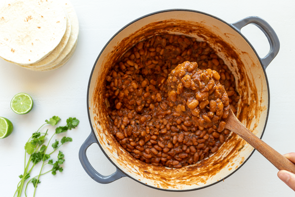 Recipe for homemade Mexican-inspired pinto beans from scratch on the stove.