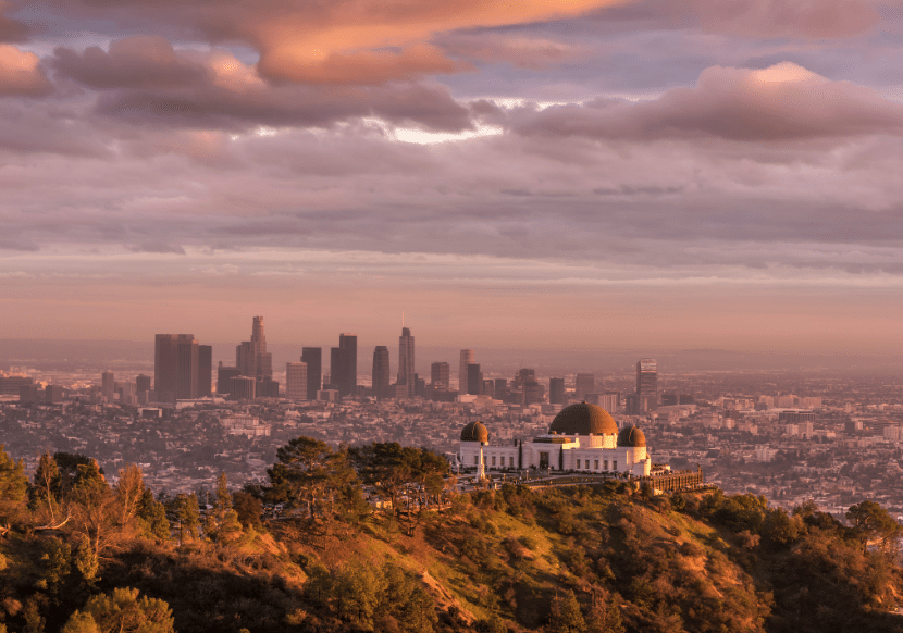 Griffith Observatory at sunset with the city skyline in the background