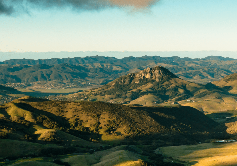 green hills and rock formations in San Luis Obispo, California