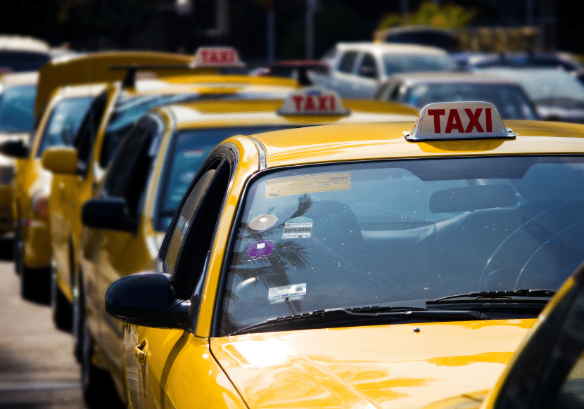 Picture of taxis lined up in Puru's capital city, where the traffic is horrific. Before you visit, read tips on the best ways to get around the city and how to travel safely via taxi.