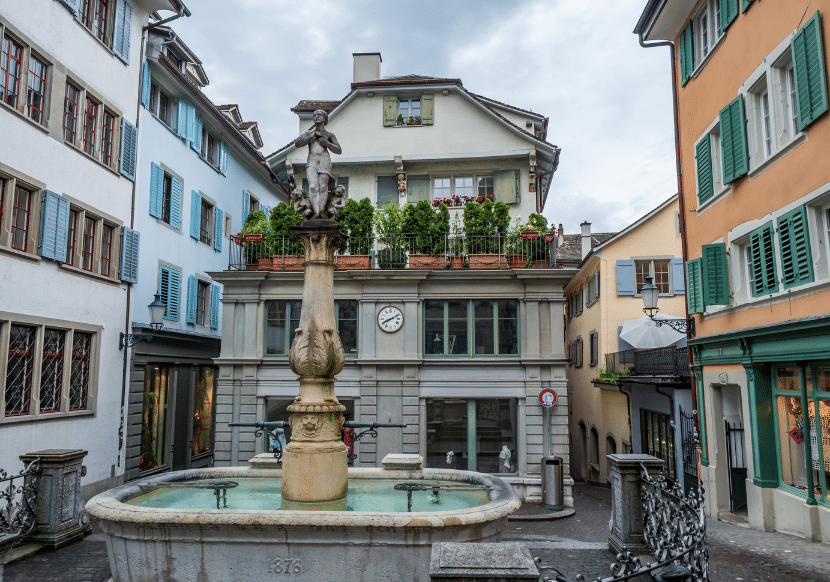 Colorful houses and shops in Old Town Zurich, a must-see on during your 48 hours in the city