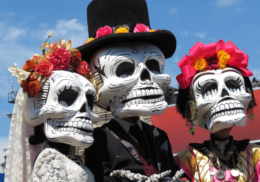 Experiencing Day of the Dead, and the colorful costumes like these, is one of the best things to do in Oaxaca.