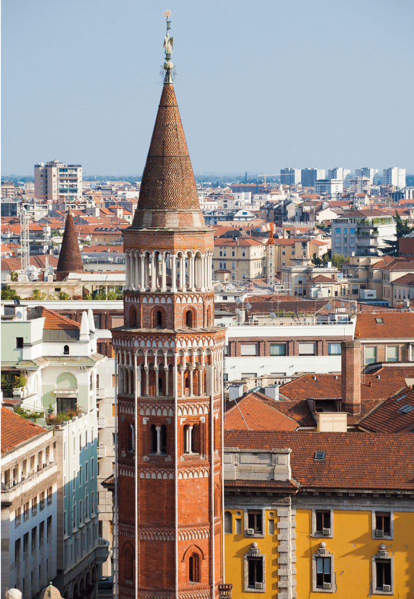 A view from the top of the Duomo, with colorful buildings and towers as far as the eye can see.