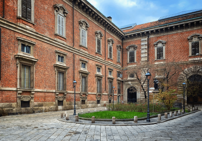 The outside of the Pinacoteca di Brera, made of brick. The Pinacoteca di Brera is a must-visit during one day in Milan. It is the city's best Italian painting gallery.